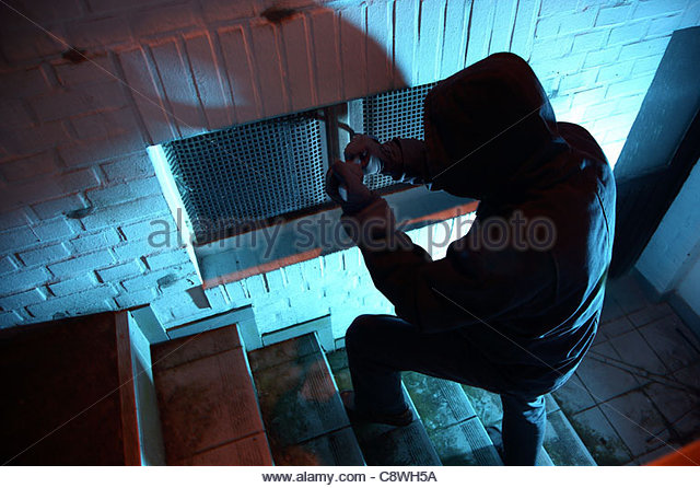 burglar-in-a-private-house-basement-nighttime-burglary-breaking-into-c8wh5a